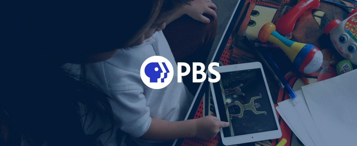 Child using PBS programming on iPad